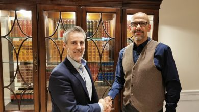 PSA Chief Executive Alex Gough (left) shakes hands with WSF Chief Executive William Louis-Marie (right)