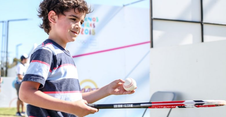 A child tries out squash during the 2018 Buenos Aires Youth Olympic Games