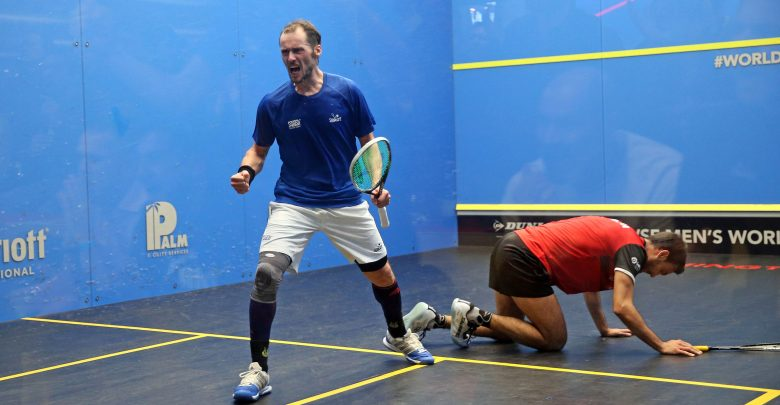 Gregory Gaultier of France (left) takes on Spain's Iker Pajares (right) during the 2019 WSF Men's World Team Squash Championship