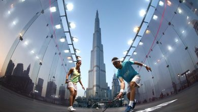 Nicol David and Mohamed ElShorbagy play squash outside Dubai's Burj Khalifa - the world's tallest building