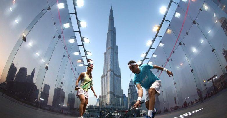 Nicol David and Mohamed ElShorbagy play squash outside Dubai's Burj Khalifa - the world's tallest building