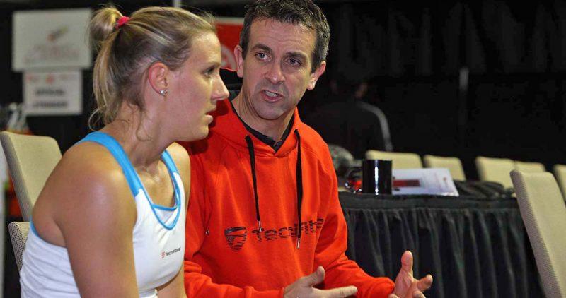Campion (right) coaches Laura Massaro during the 2014 WSF Women's World Team Squash Championship