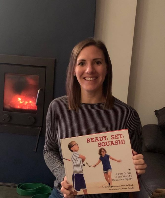 Former World No.1 Laura Massaro poses with her copy
